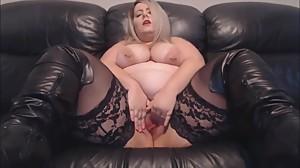 Sexy BBW Jodie Lawson rubs her wet cunt.