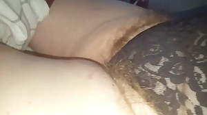 wifes long hairy pubes hanging from her..